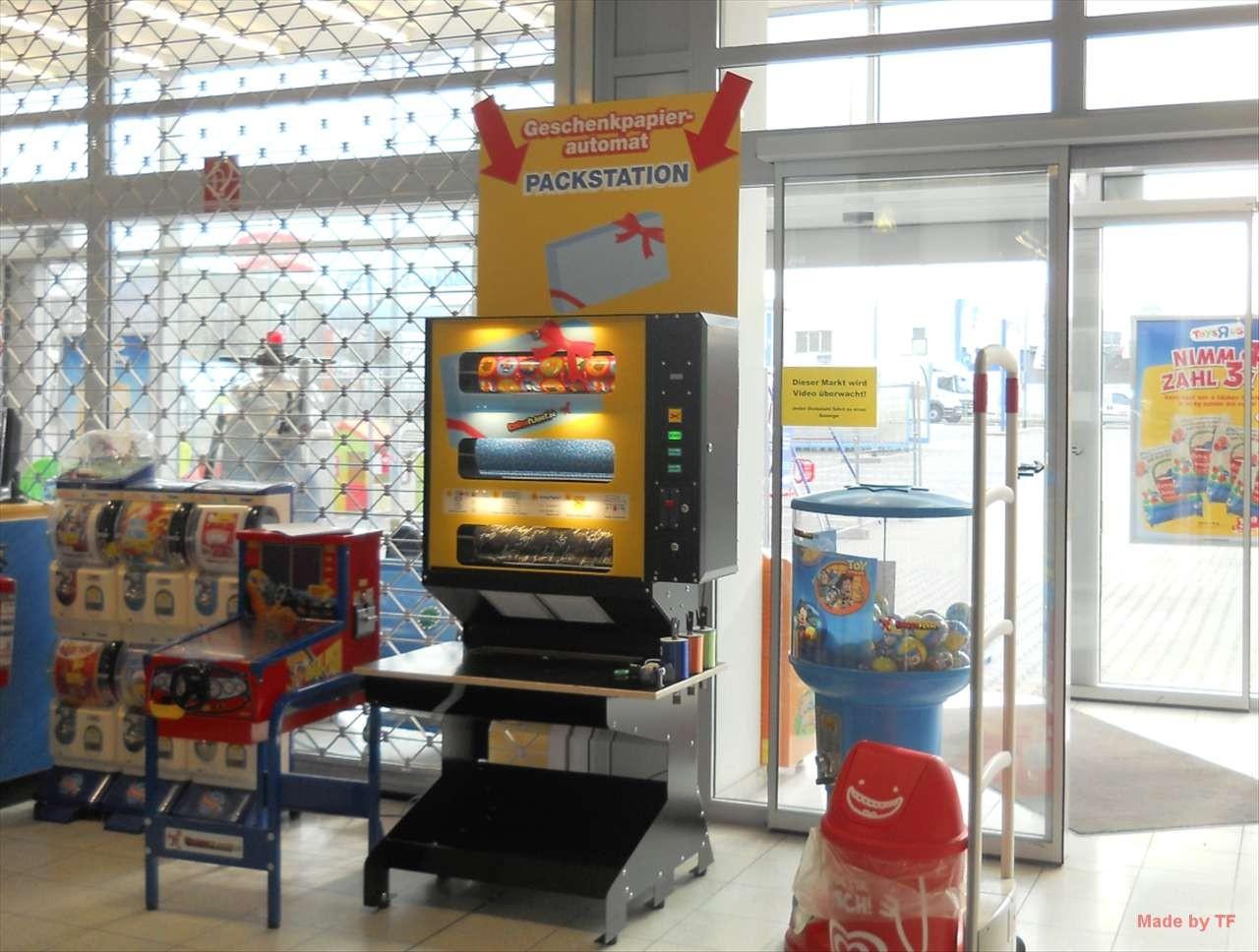 Geschenkpapier-Automat mit Packstation
